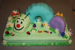 Garden theme worms and insects and flowers birthday cake.jpg