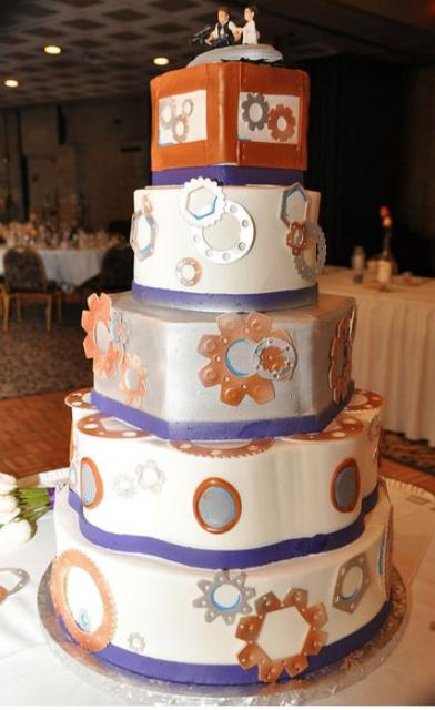 5 tier gear-theme wedding cake with bride and groom topper.JPG