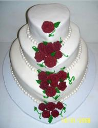 Heart-shaped 3 tier wedding cake with rose pedals and pearls.jpg