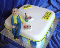 65th birthday cake for dad with newspaper and beer.JPG