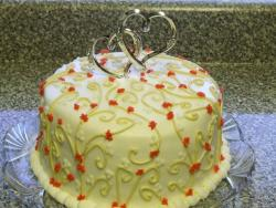 Bridal shower cake in yellow and orange small flowers.jpg