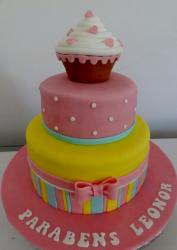 2 tier pink and yellow birthday cake for girl with cupcake on top.JPG