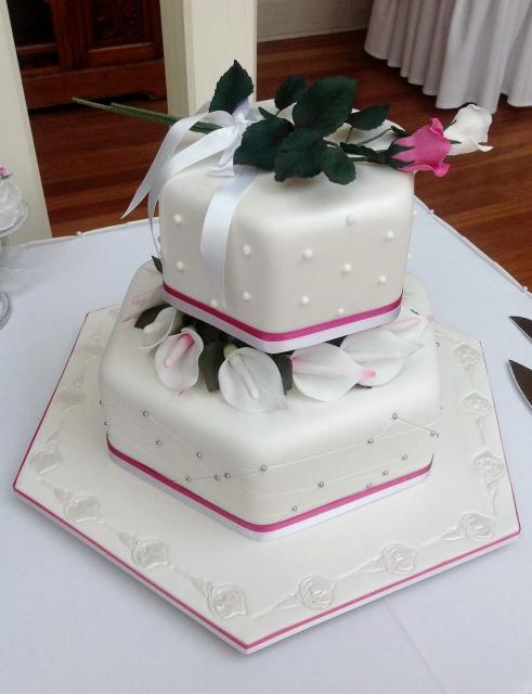 3 Tier Round White Wedding Cake With Columns Between Layers And Chocolate Flowers Jpg