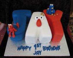 First Birthday Cake with Letters Spelled Out with Elmo & Cookie Monster.JPG