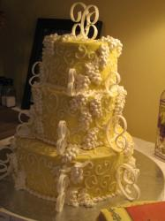 image of big bride cake in white and yellow.jpg