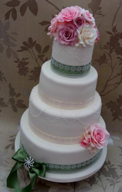 4 tier white wedding cake 4 tier white wedding cake with pink and white roses 10426