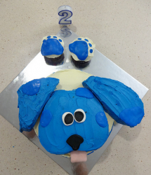 Blues Clues cake with paw prints on cupcakes_2nd birthday cake ideas.PNG
