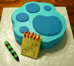 Blue's Clues paw print cake with Handy Dandy note book with crayon.PNG