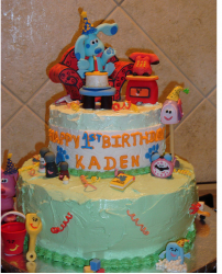 Blue Clues with friends cake in two tiers.PNG