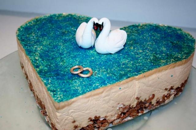 Heart shaped chocolate cream anniversary cake with dual swans and gold rings.JPG