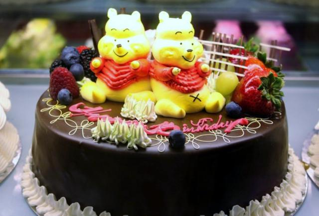 Round Winnie The Pooh Chocolate Birthday Cake With Fresh Fruit On
