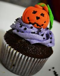 Chocolate cupcake with lavender cream and Halloween pumpkin on top.JPG