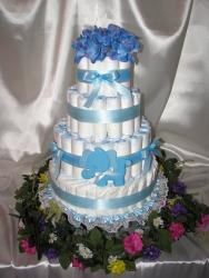 Diaper shower cake for baby boys with blue flowers on top.jpg