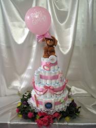 Diapers shower cake for baby girl with teddy bear on top holding a balloon.jpg