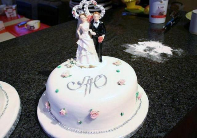 Round small one tier wedding cake with bride and groom ...