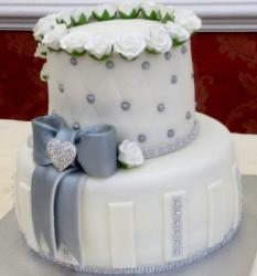 White 2 tier cake for woman with gray bow & crystal heart.JPG