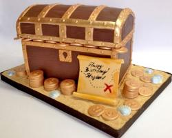 Treasure box birthday cake with gold coins and map.JPG