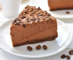 Rich fluffy chcolate cake with chips on top.JPG