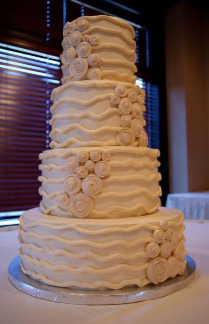 Image of four tier tan wedding mocha cake w/ swirls + lines