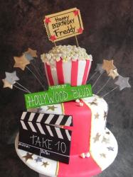2 tier popcorn and Hollywood movies theme cake with street sign.JPG