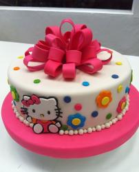 Round white Hello Kitty cake with pink bow.JPG