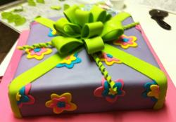 Lavender gift box cake with green bow.JPG