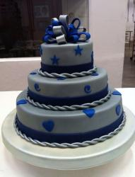 3 tier round gray cake with silver and blue bow on top.JPG