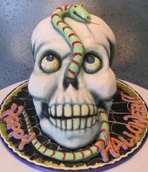 Halloween skull cake with bulging eyeballs and snake.JPG