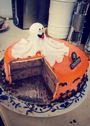 Halloween round orange ghost ice cream cake in chocolate from Cold Stone Creamery.JPG