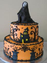 2 tier orange Halloween cake with skeleton in black cape on top.JPG