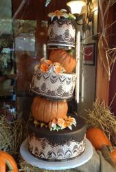 5 tier Halloween theme wedding cake with pumpkins as two of the tiers.JPG