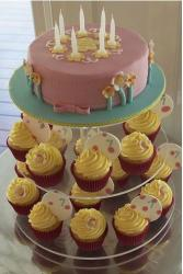 Multi-tier birthday cake with butter cream cupcakes.jpg