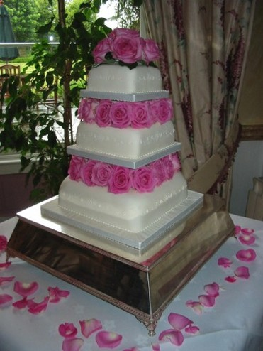 tier square wedding cake with pink roses