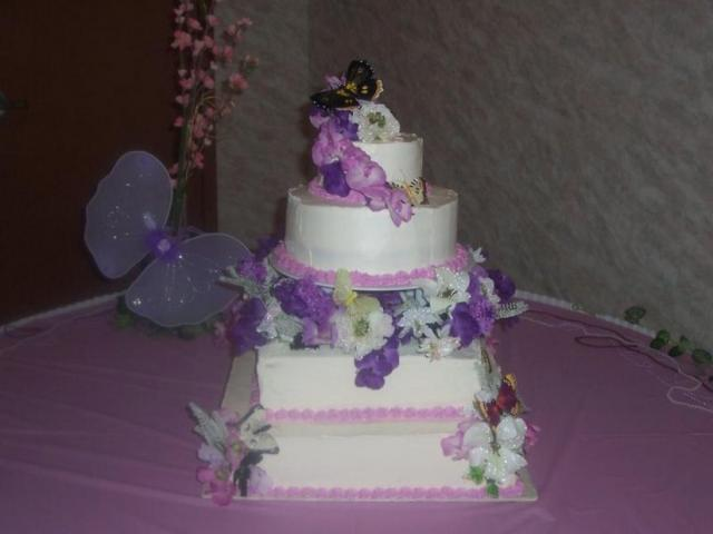 Square And Round Wedding Cake With Purple Flowers