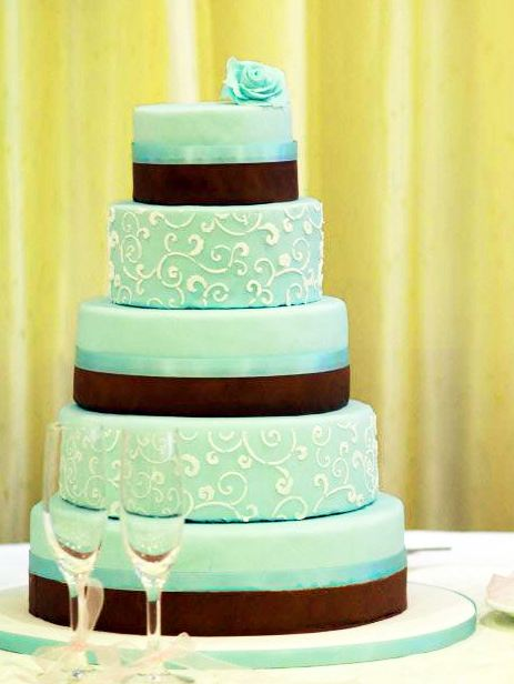 Five tier light blue wedding cake with chocolate bands and ...