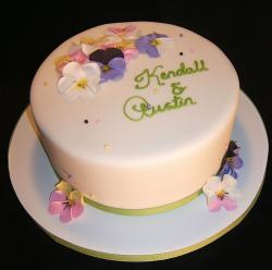Round bridal shower white cake with flower pedals.JPG