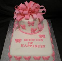2-tier bridal shower cake with large pink bowtie.JPG
