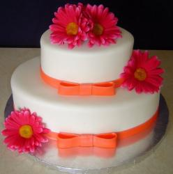 Elegant two tier round bridal shower cake with flowers and orange ties.JPG