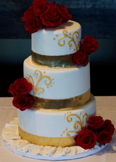 wedding cake red and gold tri tier white wedding cake with fresh roses and 23661