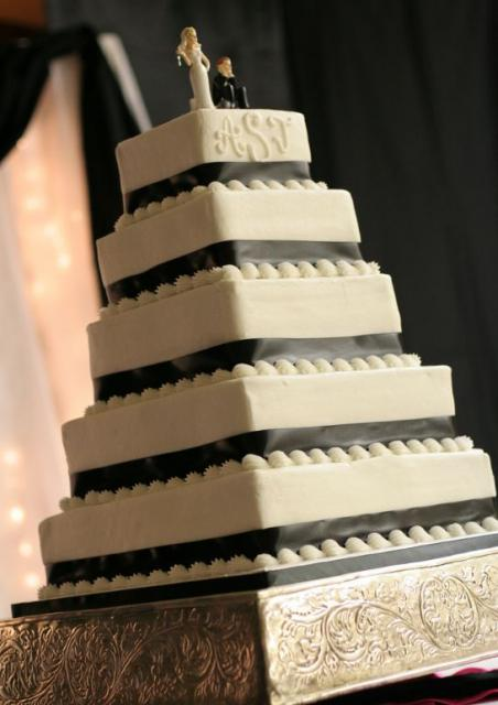 Five-tier square wedding cake with bride and groom toppers.JPG