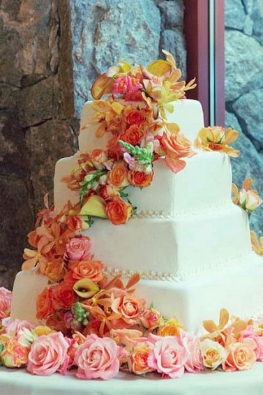 Big Fancy Wedding Cake With Colorful Flowers