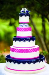 Ceramic Love Bird Toppers atop this 5 Tier Round White Wedding Cake.JPG
