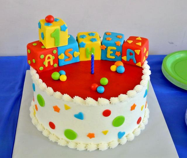 Colorful Blocks Round First Birthday Cake Spelling Out