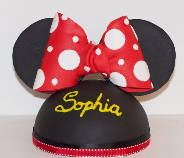 Disney cap cake with red bow.JPG