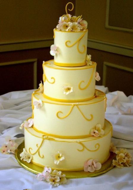 Elegant Four Tier Wedding Cake With Fresh Flower Petals Jpg
