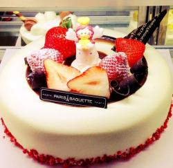 Round white single tier birthday cake with fresh strawberry and an angel topper.JPG