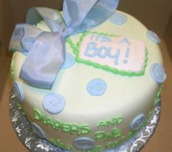 It's a Boy white cream baby shower cake with blue ribbon.JPG