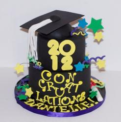 2 tier black graduation cake with stars and cap on top.JPG
