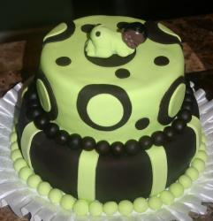 Chocolate baby shower cake with green black baby girl topper.JPG