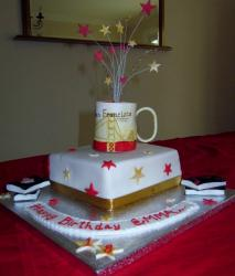 Square birthday cake with Coffee mug and streamers.JPG